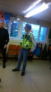 Phil gets to dress up during the visit by the police